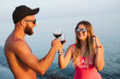 Couple dating drinking wine on the beach