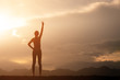 silhouette strong woman standing and fighting movitation feeling on top of mountain
