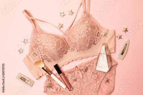 Obraz Woman elegant pink lace bra and panties, jewelry. Stylish lingerie flat lay. - fototapety do salonu