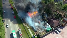 Aerial View Of A Live Fire Training Exercise With A Fully Involved House. 4K Footage From Drone