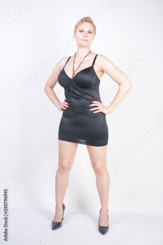 Stampa su Tela Portrait of attractive chubby young woman in tight black dress