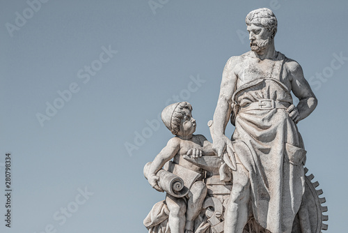 Foto op Aluminium Oost Europa Sculpture of engineer and his scholar on Zoll Bridge in Magdeburg downtown at smooth gradient background, Germany, details, closeup