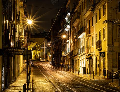 Lisbon street  at night Wallpaper Mural