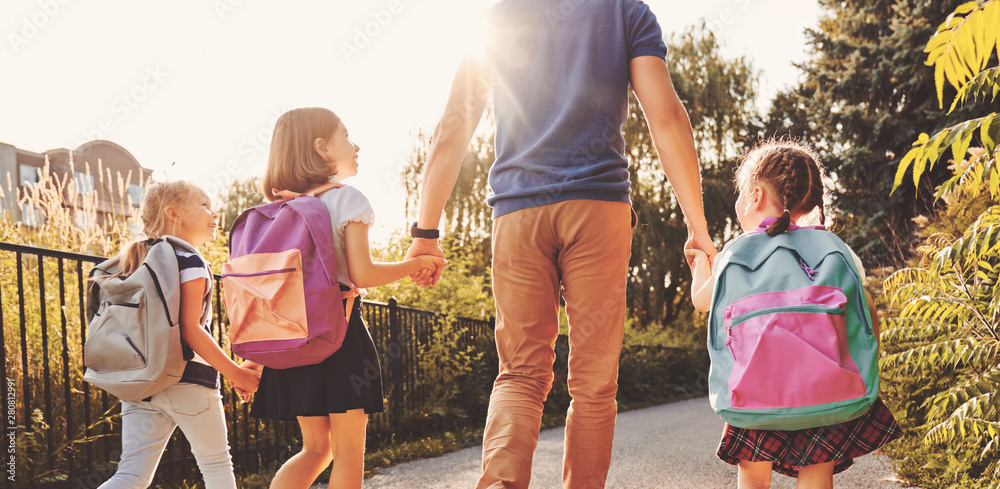 Fototapety, obrazy: Parent and pupils are going to school