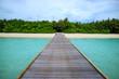 Wooden path, board walk to beach in Maldives Island