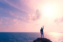 Man Rise Hands Up To Sky Freedom Concept With Blue Sky And Summer Beach Background.