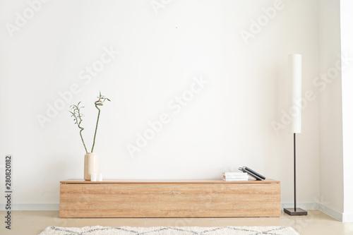 Obraz Stylish interior of modern living room with light wall - fototapety do salonu