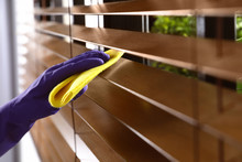 Janitor Wiping Window Blinds W...