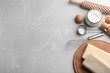 canvas print picture - Puff pastry dough and ingredients on grey table, flat lay. Space for text