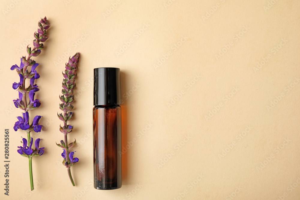 Obraz Bottle of essential oil and sage flowers on color background, flat lay. Space for text fototapeta, plakat
