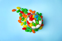 Flat Lay Composition With Bowl Of Jelly Beans On Color Background