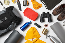 Flat Lay Composition With Different Camping Equipment On White Background