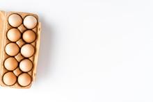 Chicken Eggs In Box On White T...