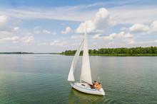 Sailboat Sail Along The Scenic River