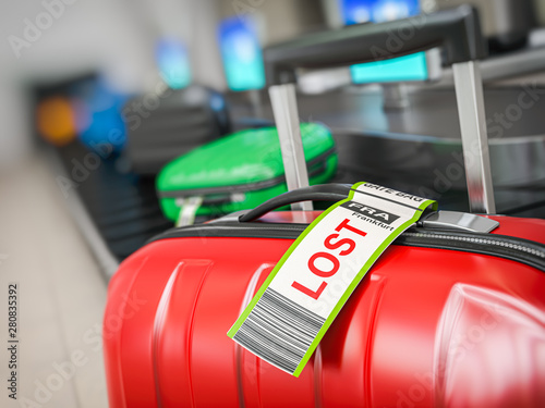 Fotografie, Obraz  Suitcase with lost sticker on an airport baggage conveyor or baggage claim transporter