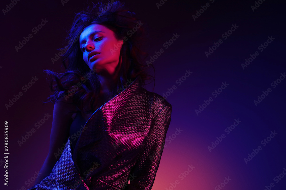 Fototapeta High fashion girl model in stylish clothing in color neon light