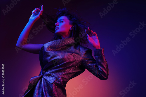 Fotografie, Obraz  Style. High fashion girl model in stylish clothes in neon lights