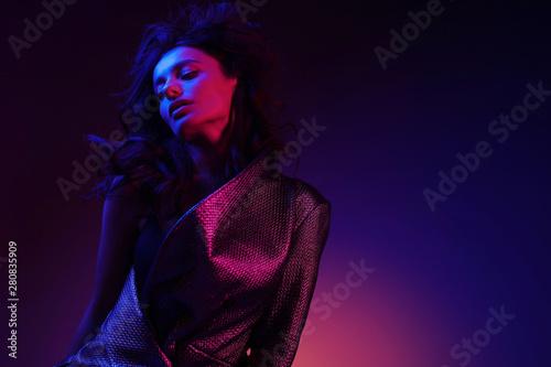 Obraz High fashion girl model in stylish clothing in color neon light - fototapety do salonu