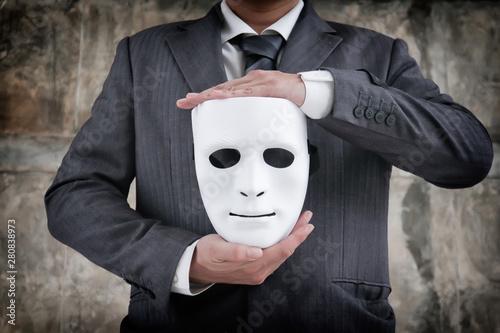 Businessman holding white mask in his hand dishonest cheating agreement Fototapet