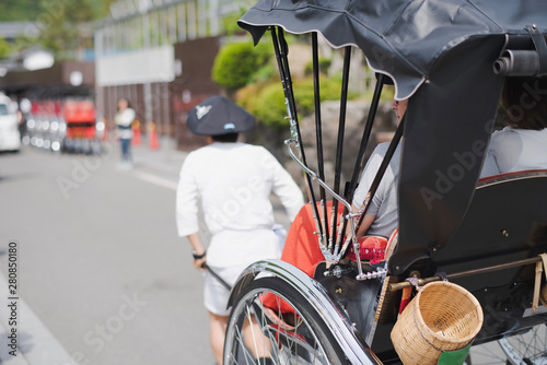 The young man with old style trailer is  taking the tourist for sightseeing in Arashiyama district, Kyoto, Japan Canvas-taulu