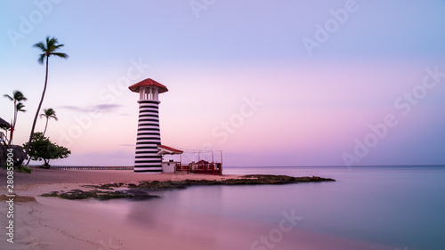 Sunrise at Bayahibe beach with smooth water, La Romana, Dominican republic Fotobehang