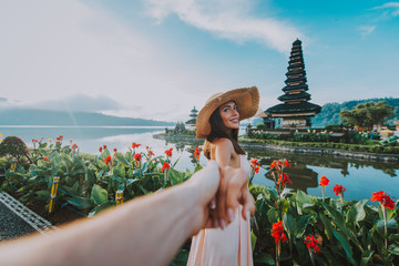 Couple spending time at the ulun datu bratan temple in Bali. Concept about exotic lifestyle wanderlust traveling