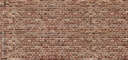 Montage in der Fensternische Graffiti Brick texture. Panoramic background of wide old red brick wall texture. Home or office design backdrop