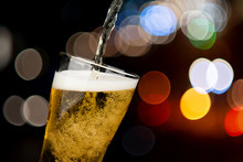 Beer Pouring From Bottle Into Glass On Bokeh Light Night Background Drinking Alcohol Celebration Concept Design