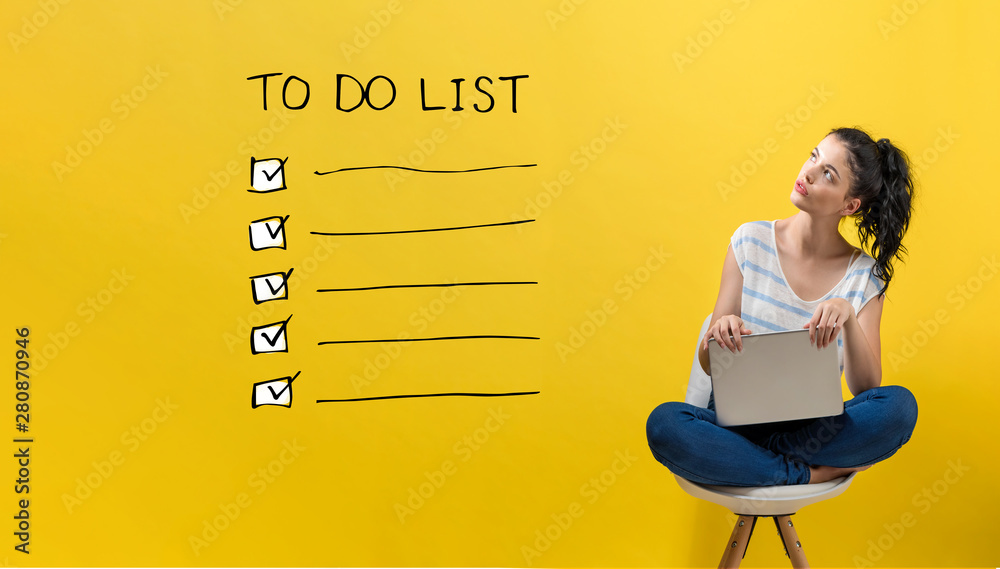Fototapeta To do list with young woman using a laptop computer