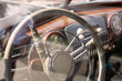 Old cabin, console and steering wheel in a vintage retro car