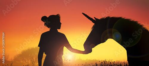 unicorn and girl at sunset
