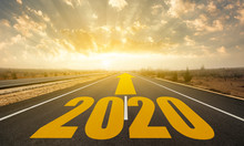 The Word 2020 Written On Highway Road. Concept For New Year 2020.