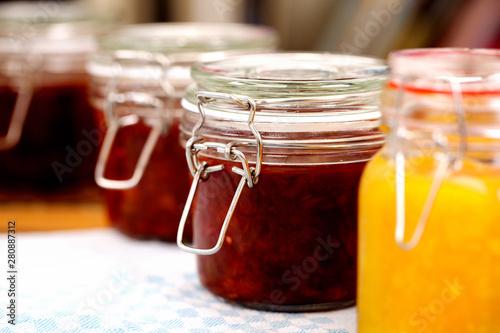 Glass jars with homemade marmalade or