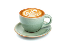 Side View Of Hot Latte Coffee With Latte Art In A Ceramic Green Cup And Saucer Isolated On White Background With Clipping Path Inside.