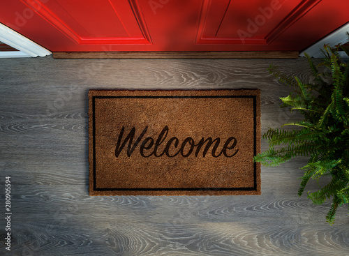 Fototapeta Overhead view of welcome mat outside inviting front door of house