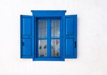 Blue Window With Open Shutters And White Wall Of Greek House In Amorgos, Greece.