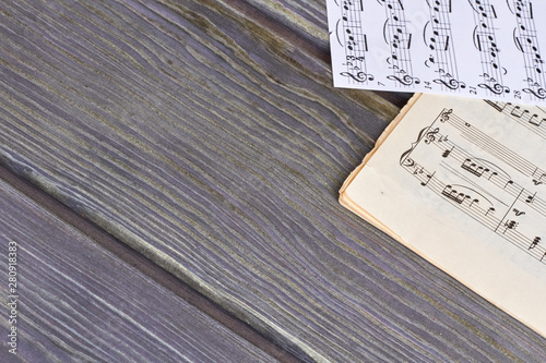 Valokuva Sheets of musical notes on wooden background
