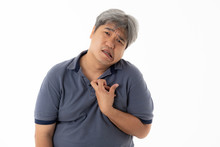 Asian Middle-aged Man Are Patients, His Hands Are Kinking Due To A Nervous System Illness And Paralysis, On White Isolated Background, To Health Concept.