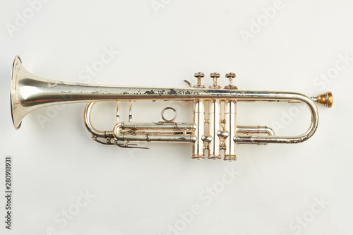 Rusty trumpet on white background. Old classical trumpet. Vintage musical instrument. - 280918931