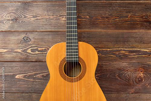 Acoustic guitar on dark wooden background Canvas Print