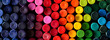 Leinwandbild Motiv Box of crayons in a rainbow of colors background