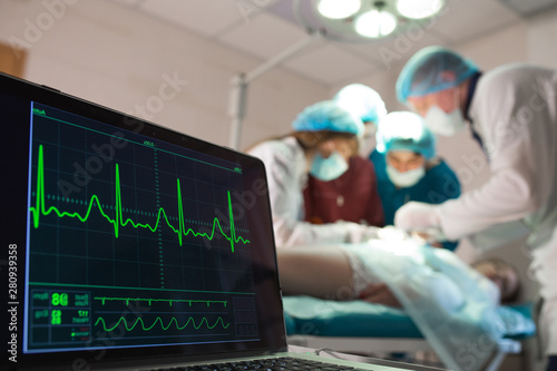Obraz na płótnie Monitoring of ECG and saturation O2 in the patient in the operating room