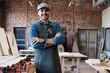 Leinwandbild Motiv Successful handsome businessman with stylish cap work in carpentry