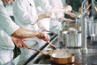 canvas print picture - Chef cooking vegetables in wok pan. Shallow dof.