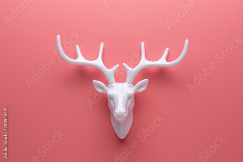 Foto op Canvas Hert White reindeer with white antlers. Minimal New Year or Christmas background concept.