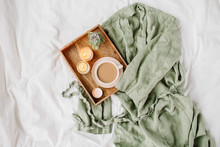 White Bedding With Dressing Gown. Tray Of Coffee And Candles. Breakfast In Bed.  Scandinavian Style.  Flat Lay, Top View