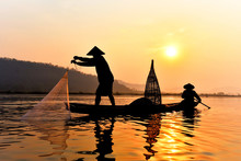 Asia Fisherman Net Using On Wooden Boat Casting Net Sunset Or Sunrise In The Mekong River / Silhouette Fisherman Boat With Mountain Background Life Person Countryside