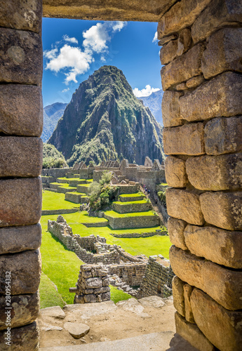 The Inca ruins of Machu Picchu, UNESCO World Heritage Site through the frame of Wallpaper Mural