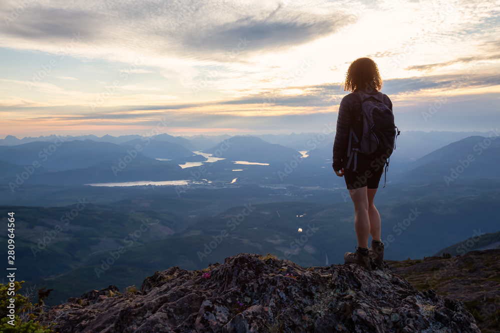 Fototapety, obrazy: Adventurous girl hiking the beautiful trail in the Canadian Mountain Landscape during a vibrant summer sunset. Taken at Mt Arrowsmith, near Nanaimo, Vancouver Island, BC, Canada.