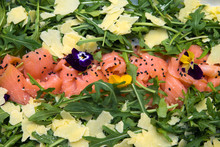 Abstract Closeup Of Antipasti Mixed Event Catering Platter With Smoked Salmon, Ceese And Rocket